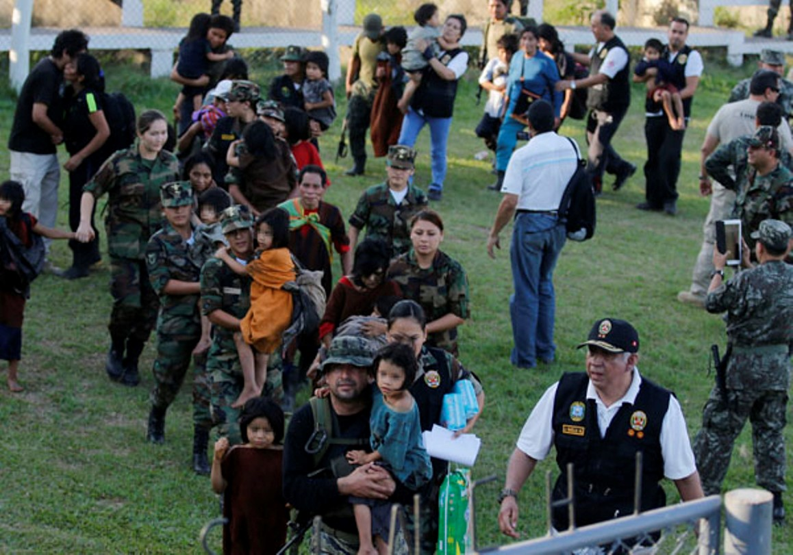 Peruvian Soldiers, Police Rescue Children and Families from the Shining Path
