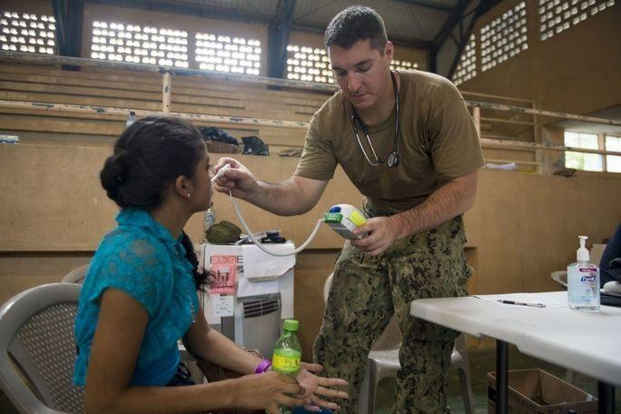 Hospital Corpsman 3rd Class Christopher Archuleta, attached to Naval Hospital Jacksonville, Florida, uses a digital thermometer to take the temperature of a patient at the CP-17 medical site in Puerto Barrios, Guatemala. (Photo: Mass Communication Specialist 2nd Class Shamira Purifoy/U.S. Navy)