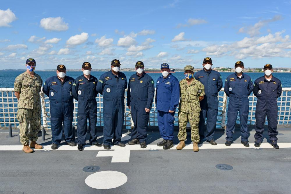 U.S. Coast Guard Captain Adam Morrison, commanding officer of the USCG Cutter Stone (WMSL 758), poses with members of the Brazilian Navy on the Stone's flight deck near Salvador, Brazil, on February 10, 2021. Capt. Morrison gave Brazilian service members a tour of the cutter before giving a talk about the Stone's missions and capabilities. (Photo: U.S. Coast Guard Petty Officer Third Class John Hightower)