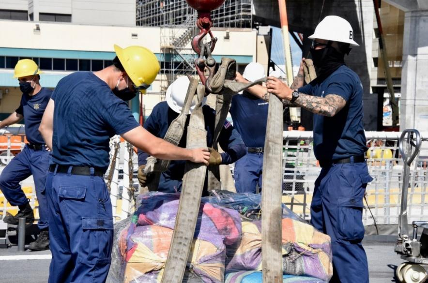 The U.S. Coast Guard Cutter Hamilton (WMSL 753) crew members offload approximately 11,500 pounds of cocaine and approximately 17,000 pounds of marijuana, Aug. 27, 2020, in Port Everglades, Florida. The drugs were interdicted by crews from Coast Guard Cutter Resolute (WMEC 620), Cutter Hamilton and USS Shamal (PC 13), USS Nitze (DDG 94), while on patrol in the eastern Pacific Ocean from suspected drug smuggling vessels. (Photo: U.S. Coast Guard photo by Petty Officer 3rd Class Brandon Murray)
