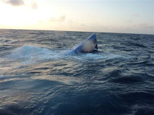 A sinking self-propelled semi-submersible vessel was interdicted in the Western Caribbean Sea March 30 by the crews of the Coast Guard Cutter Decisive, Coast Guard Cutter Pea Island and the Honduran Navy. The cutter Pea Island and Decisive's pursuit boatcrews interdicted the SPSS and detained four suspected smugglers. The SPSS sank during the interdiction in thousands of feet of water. (Courtesy of the U.S. Coast Guard)