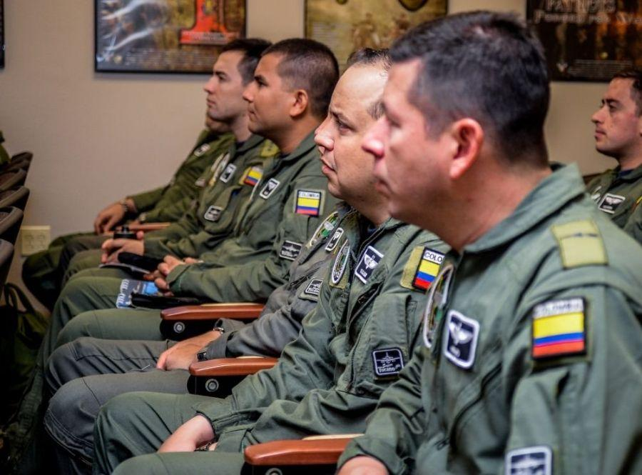 Colombian Air Force aviators attend a pre-flight briefing during Exercise Green Flag East at Barksdale Air Force Base, La., on August 17th, 2016. The briefing provides aviators with local weather updates and situational procedures crucial to mission planning. (U.S. Air Force photo / Senior Airman Mozer O. Da Cunha)