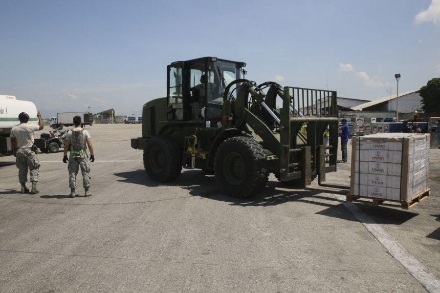 Airmen deployed in support of Joint Task Force Matthew unload supplies provided by USAID at Port-au-Prince, Haiti, on October 8th, 2016.Service members with JTF Matthew successfully delivered over 39,000 pounds of supplies to the local population affected by Hurricane Matthew, utilizing CH-53E Super Stallions and CH-47 Chinooks. (Photo: Sgt. Ian Ferro/U.S. Marine Corps Forces South)