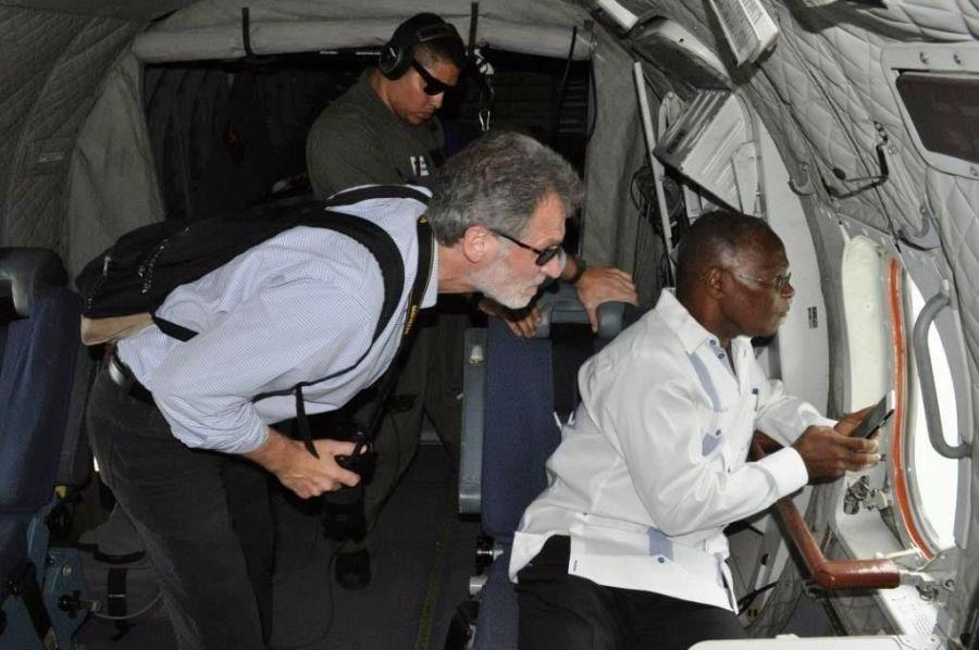 Haitian President Jocelerme Privert (right), and U.S. Ambassador to Haiti Peter F. Mulrean (left), observe the damage caused by the hurricane from a Coast Guard Air Station Miami HC-144 Ocean Sentry aircraft flying over Haiti to conduct a post-storm damage assessment on October 5. (Photo: U.S. Coast Guard)