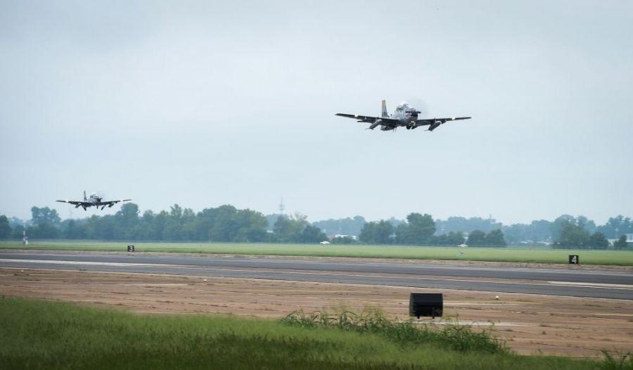 Two Colombian Air Force A-29B Super Tucanos take-off during Exercise Green Flag East at Barksdale Air Force Base, La., on August 17th, 2016. The flight teams consisted of Colombian Air Force aviators and U.S. Air Force A-10 pilots. The exercise provides aviators from both countries with the opportunity to learn from each other. (U.S. Air Force photo / Senior Airman Mozer O. Da Cunha)