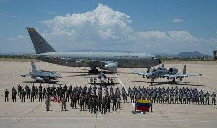 Airmen from the Colombian Air Force (FAC) and U.S. Air Force pose for a group photo in front of Colombian aircraft, a 767 Multi-Mission Tanker Transport Jupiter aircraft and a Kfir fighter jet, and U.S. Air Force aircraft, an F-16 Fighting Falcon and A-10 Thunderbolt II, on the flightline at Davis-Monthan Air Force Base, Arizona, July 13, 2018. Six Colombian Kfirs from FAC's Combat Squadron No. 111, arrived to train with the 162nd Wing's F-16s and the 354th Fighter Squadron's A-10 Thunderbolt IIs in preparation for Red Flag 18-3.(Photo: U.S. Air Force Staff Sgt. Angela Ruiz