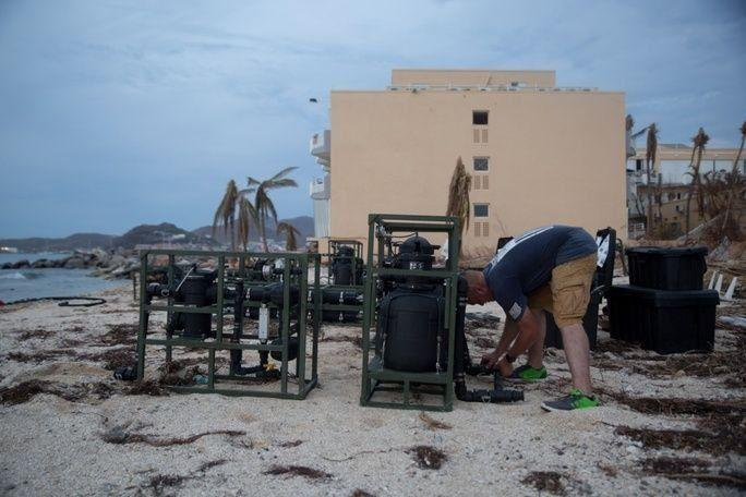 U.S. Marine Corps Corporal Brandon Fenley, a water support technician with Joint Task Force-Leeward Islands, sets up the Lightweight Water Purification System at a water distribution site on Saint Martin, on September 14th. (Photo: U.S. Marine Corps Sergeant Ian Leones)