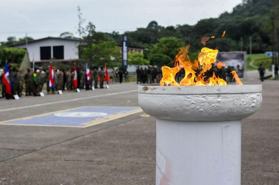 The torch was lit during an opening ceremony commencing Fuerzas Comando, July 16, 2018, at the Instituto Superior Policial, Panama. (Photo: U.S. Army Sgt. Alexis Velez)The opening ceremony for the 14th Fuerzas Comando (FC) exercise kicked off the Special Operations Forces competition July 16 at the Instituto Superior Policial, in Panama. Military and police Special Operations Forces from Argentina, Belize, Brazil, Chile, Colombia, Costa Rica, Ecuador, Dominican Republic, El Salvador, Guatemala, Haiti, Honduras, Jamaica, Nicaragua, Panama, Paraguay, Peru, Trinidad and Tobago, and the United States compete for the 2018 Fuerzas Comando title in Panama City, Panama, from July 16-26. FC is an annual multinational Special Operations Forces skills competition sponsored by U.S. Southern Command and hosted in 2018 by Panama's Ministry of Public Security. Through friendly competition, FC promotes interoperability and military-to-military relationships, increases training knowledge, and improves regional security.