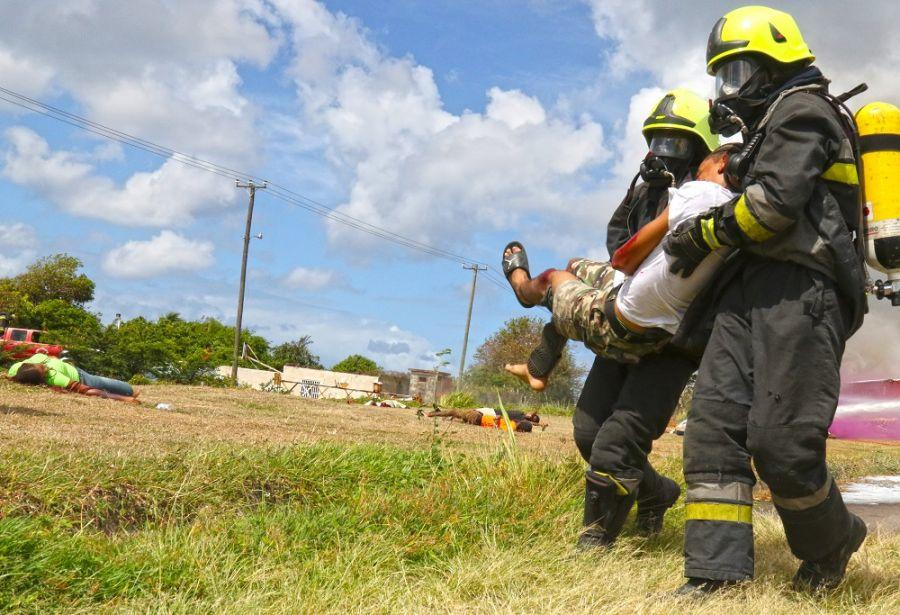Firefighters of the Saint Kitts-Nevis Fire and Rescue Services carry a casualty during a simulated plane crash scenario as part of Tradewinds 2018, in Basseterre, Saint Kitts and Nevis, June 9th. (Photo: U.S. Army National Guard Staff Sergeant Shane Hamann)