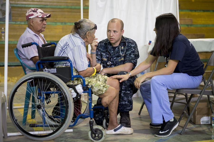 As part of the 2018 Continuing Promise mission, U.S. Navy Lieutenant Joe Guerin observes a patient's symptoms during a medical event in Puerto Cortés, Honduras on March 15th. (Photo: U.S. Navy Specialist First Class Mike DiMestico)
