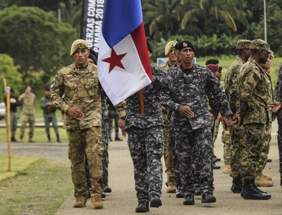 Panamanian comandos return to their place after passing the torch during the opening ceremony for Fuerzas Comando 2018. (Photo: U.S. Army Staff Sgt. Brian Ragin)