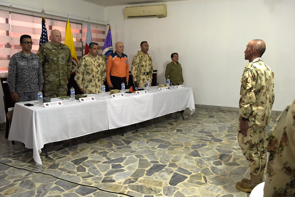 A Colombian Army soldier addresses the head table at the opening ceremony for Exercise Vita at Buenavista Air Base, Colombia, March 9, 2020. The exercise focuses on reinforcing longstanding ties and enhancing participants' overall readiness while demonstrating U.S. Southern Command's enduring promise to the Americas. (Photo: U.S. Air Force Technical Sergeant Daniel Owen)