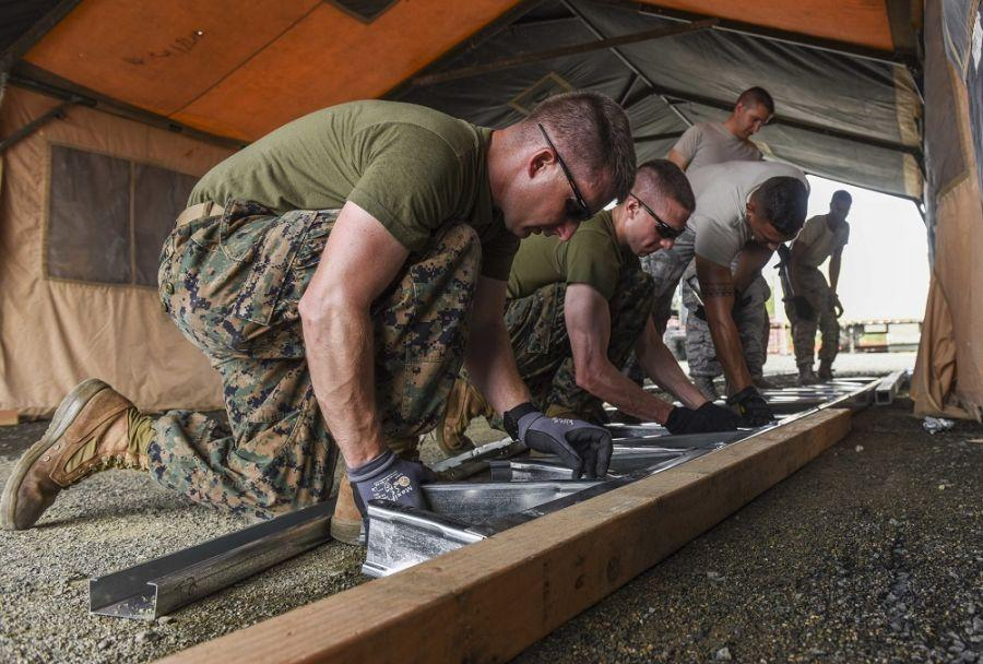 Engineers deployed with SOUTHCOM for exercise New Horizons 2018, assemble a framework that will support the roof of a building in a construction site in Darién, Panama, April 14th. (Photo: U.S. Air Force Senior Airman Dustin Mullen)