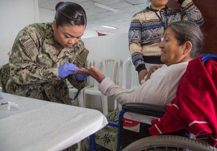 U.S. Navy Hospital Corpsman Third Class Makhazandra Navarro, deployed with the USNS Comfort, draws blood from a patient at one of two medical sites in Paita, Peru, November 2nd. (Photo: U.S. Army Specialist Joseph DeLuco)
