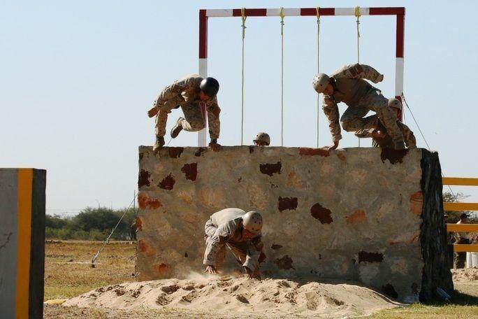 Team Chile jumps over an obstacle. Fuerzas Comando fosters interoperability among partner nations through friendly competition. (Photo: U.S. Army Spc. Elizabeth Williams)