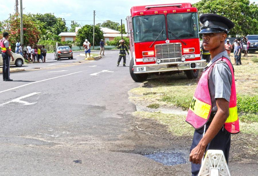 Royal St. Christopher and Nevis Police Force Constable Anson Belle conducts traffic control during an airplane crash simulation as part of Tradewinds 2018, June 9, 2018, in Basseterre, St. Kitts. (Photo: U.S. Army National Guard Staff Sgt. Shane Hamann, 102nd Public Affairs Detachment)