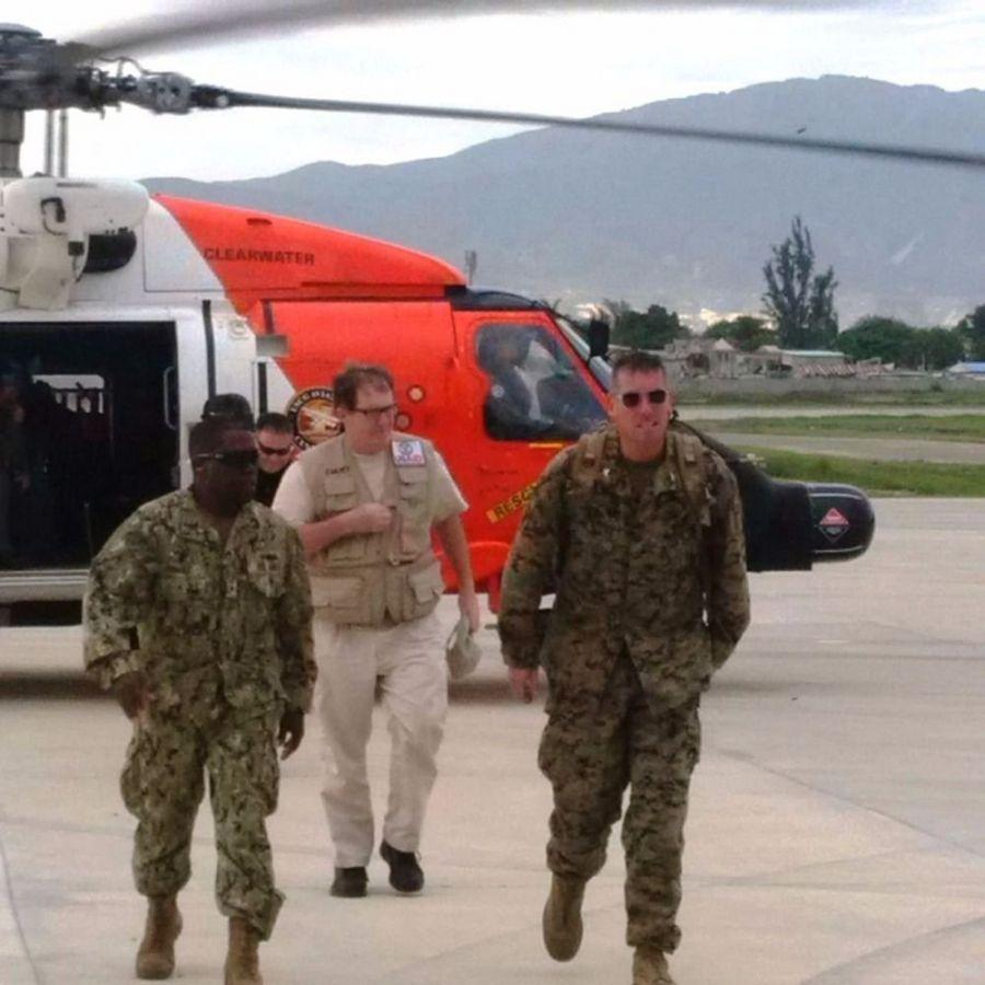 U.S. Navy Rear Admiral Cedric Pringle, commander of the Joint Task Force Matthew (right); U.S. Marine Corps Col. Tom Prentice, commanding officer of the U.S. Marine Air-Ground Task Force; and Tim Callaghan (center), with USAID, disembark U.S. Coast Guard helicopter CG-6013 after surveying the damage left behind by Hurricane Matthew in Haiti for the first time. (Photo: U.S. Coast Guard)