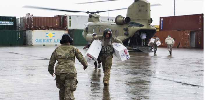 U.S. marines with Joint Task Force-Leeward Islands stack boxes of tarps from the U.S. Agency for International Development as they prepare supplies for distribution at Douglas-Charles Airport in Melville Hall, Dominica.Joint Task Force-Leeward Islands (JTF-LI) is providing disaster relief support to Dominica in the aftermath of Hurricane Maria. The task force previously provided assistance to St. Martin after Hurricane Irma. The task force's mission is to support USAID relief operations in order to save and sustain lives and reduce human suffering. At the request of USAID, JTF-LI has deployed aircraft and service members to assist in delivering relief supplies to Dominica in the aftermath of Hurricane Maria. The task force is a U.S. military unit composed of marines, soldiers, sailors and airmen, and represents U.S. Southern Command's primary response to the hurricanes that have affected the eastern Caribbean.