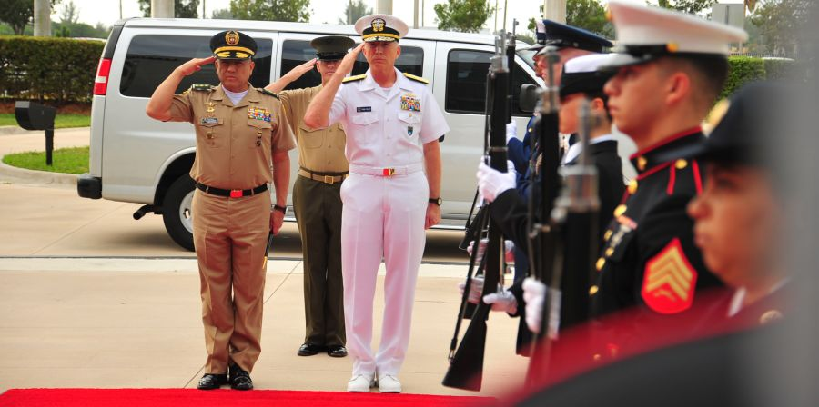 U.S. Navy Admiral Craig S. Faller, commander of SOUTHCOM, and Colombian Army Major General Luis Navarro Jiménez, commander of Colombia's Military Forces, render honors at SOUTHCOM headquarters.